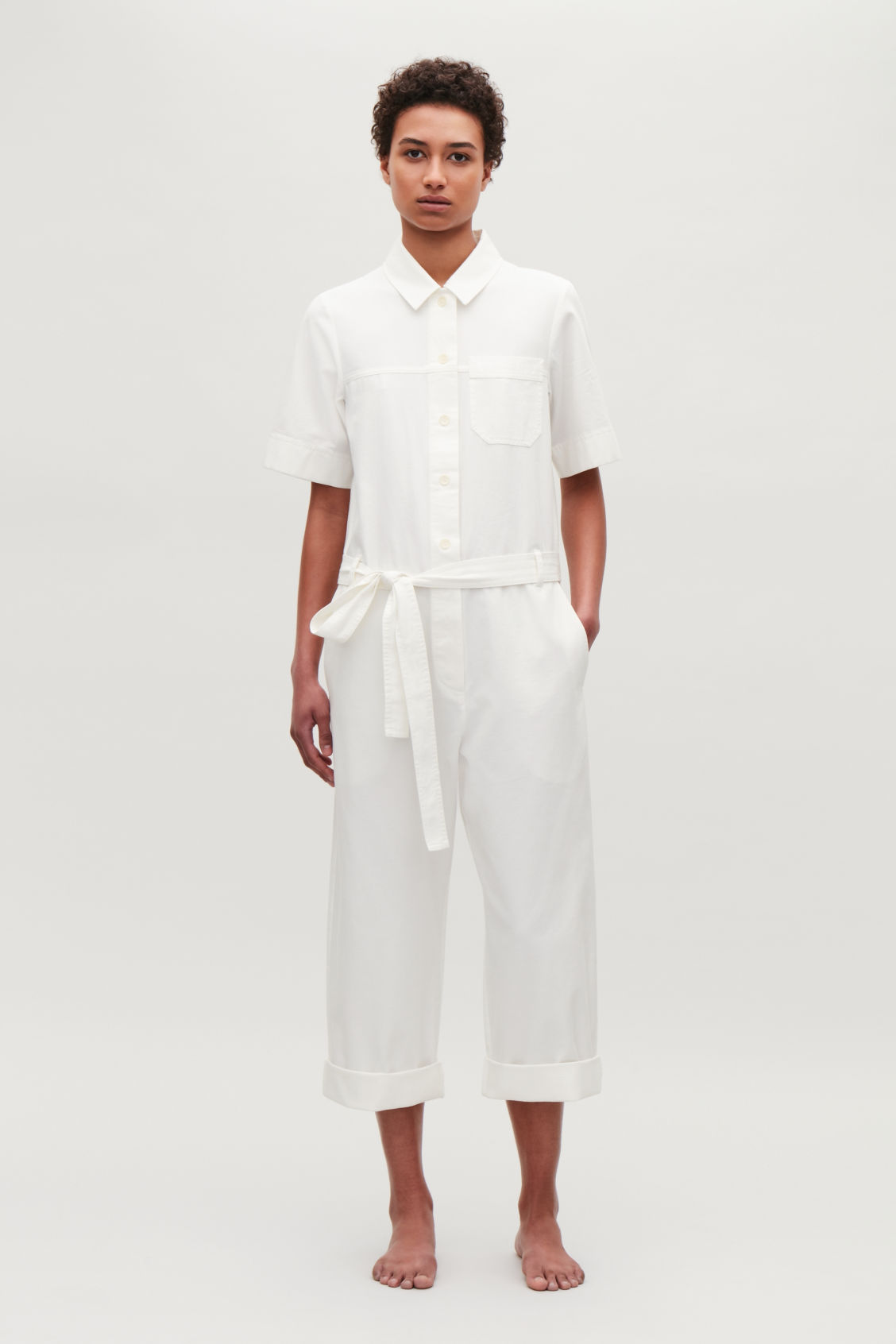 Model front image of Cos belted cotton jumpsuit in neutral