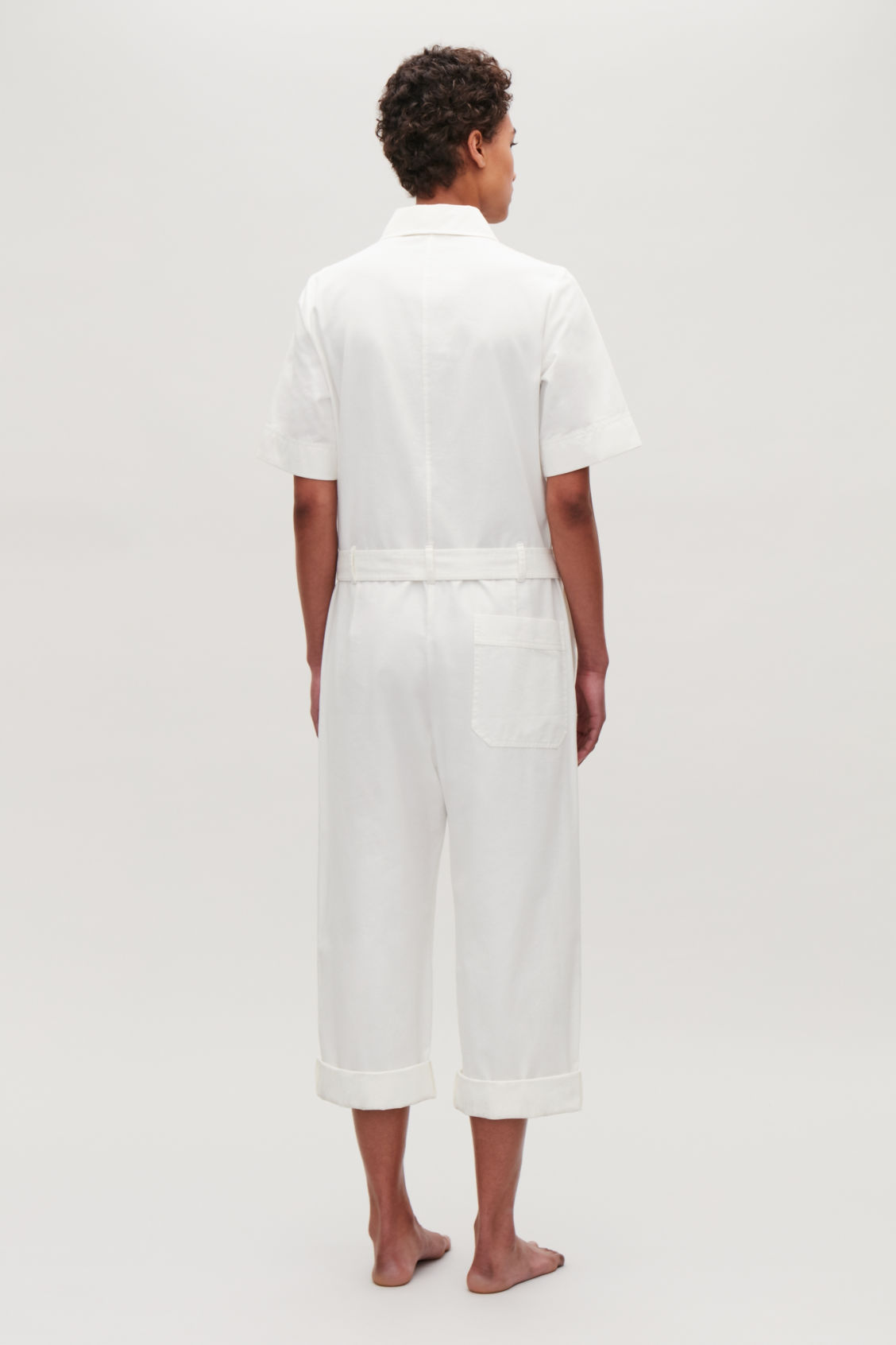 Model side image of Cos belted cotton jumpsuit in neutral