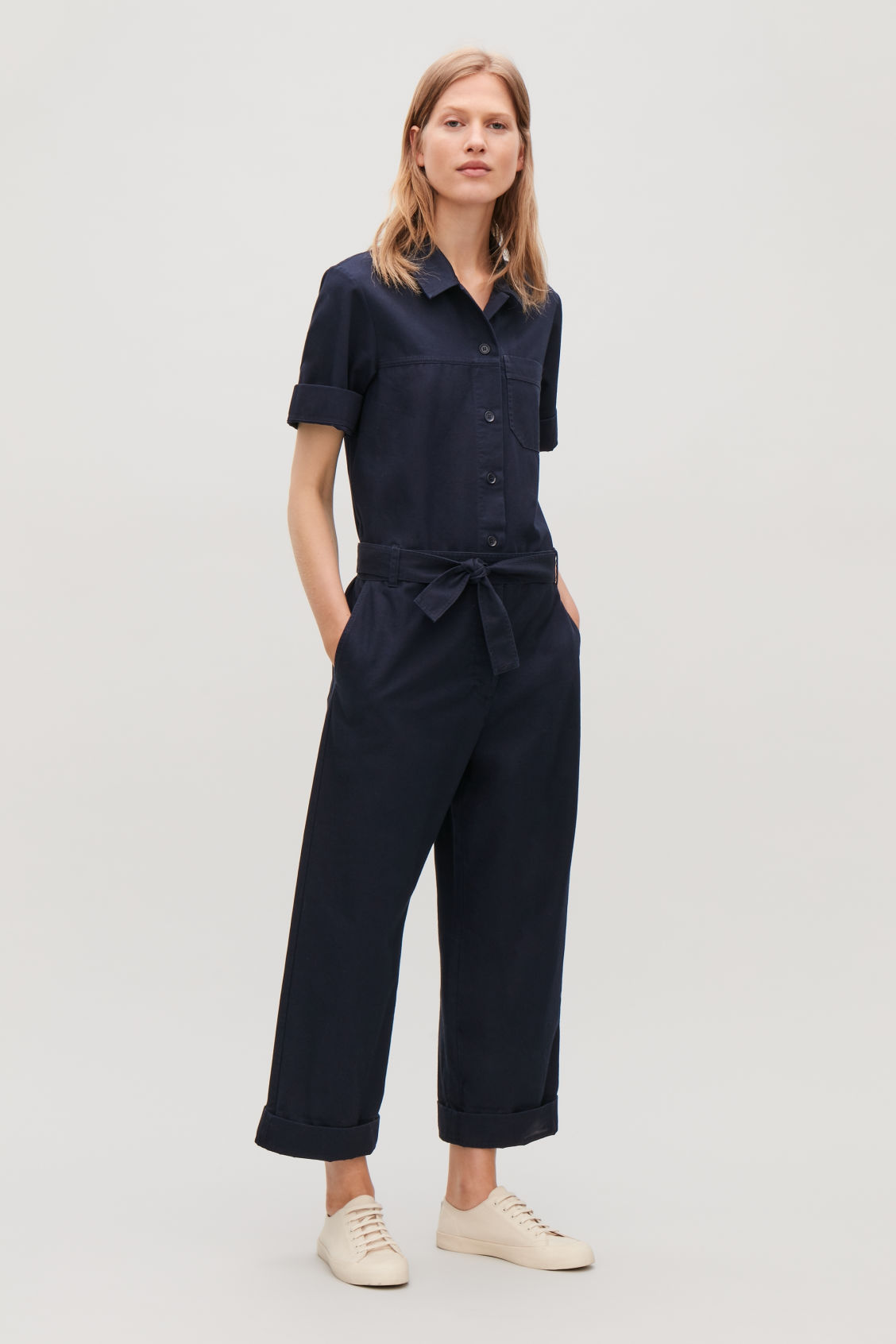 c9b9f23d1eb83 Model front image of Cos belted cotton jumpsuit in blue
