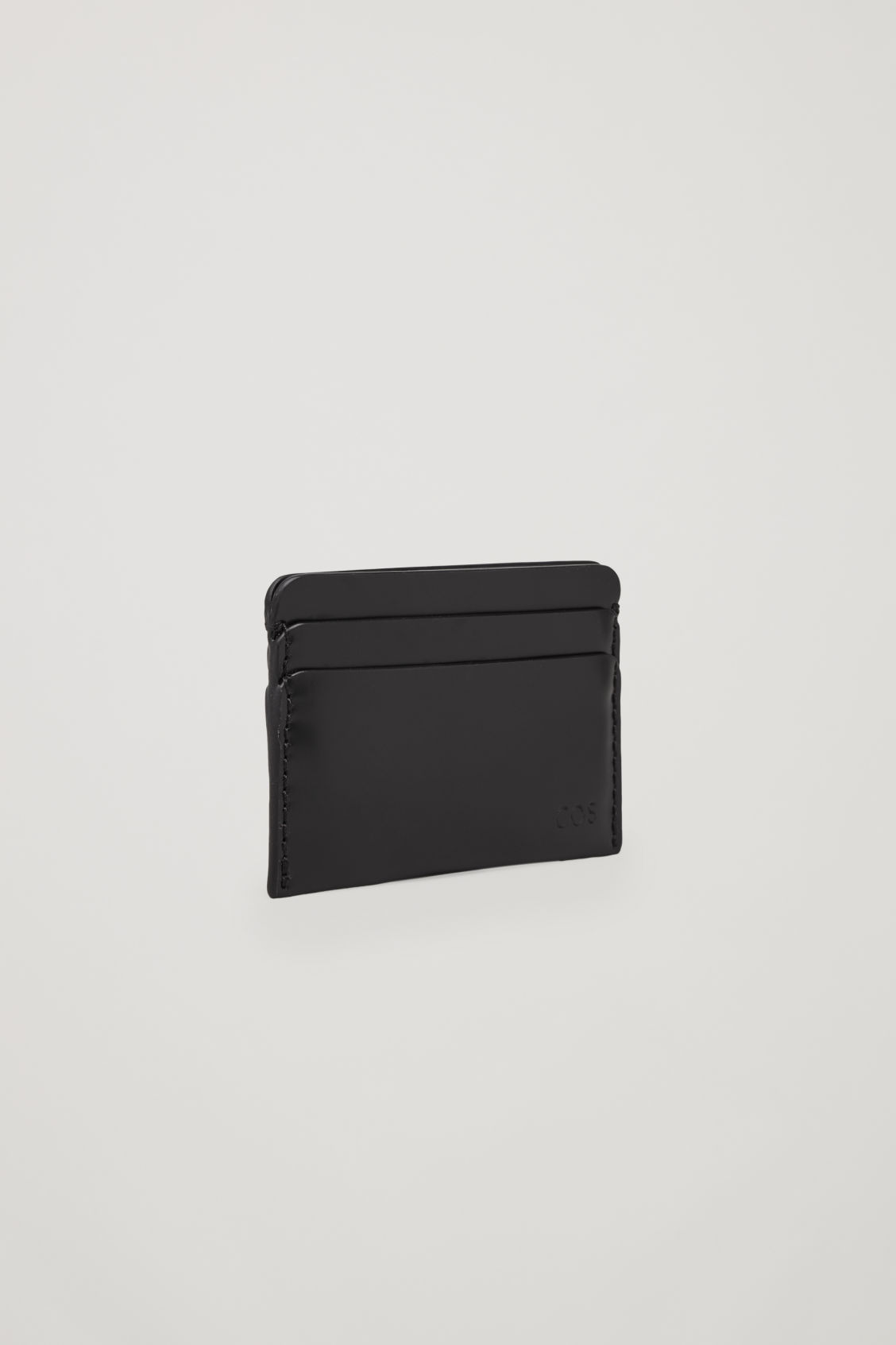 Model side image of Cos round-edged leather cardholder  in black