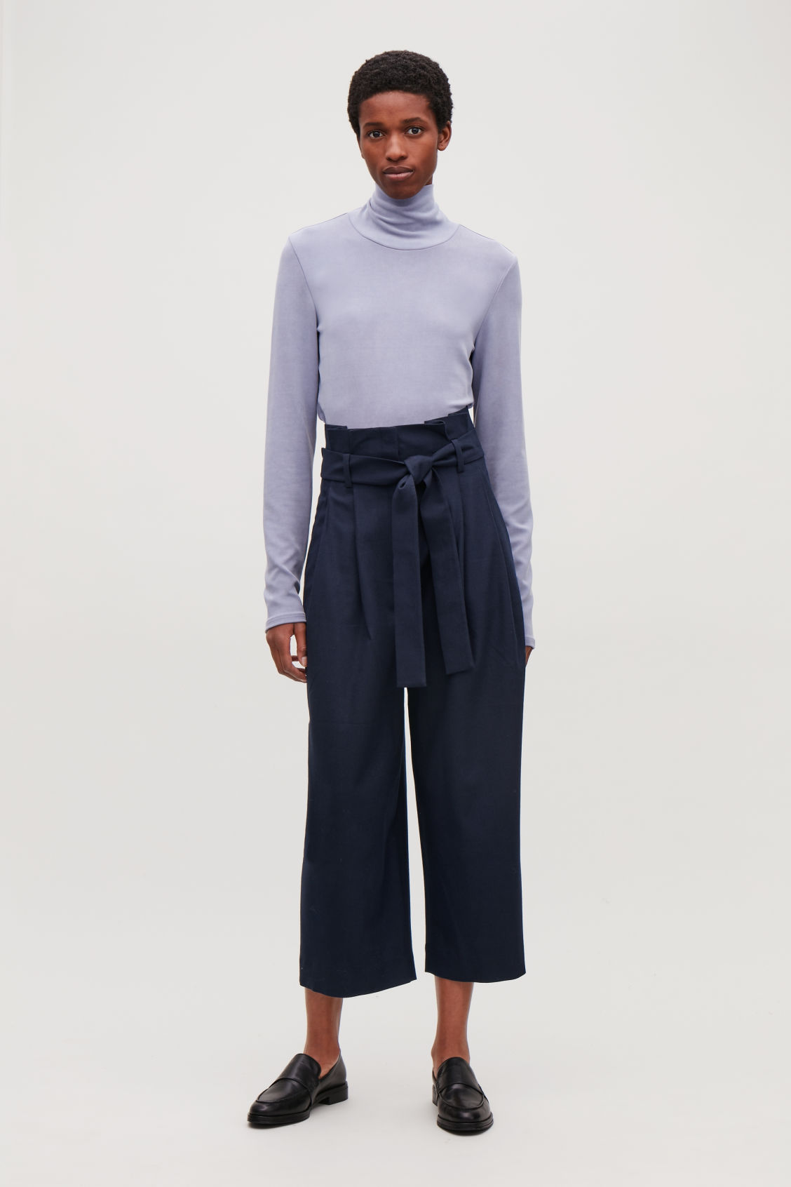 Model front image of Cos wool trousers with pleated waist  in blue