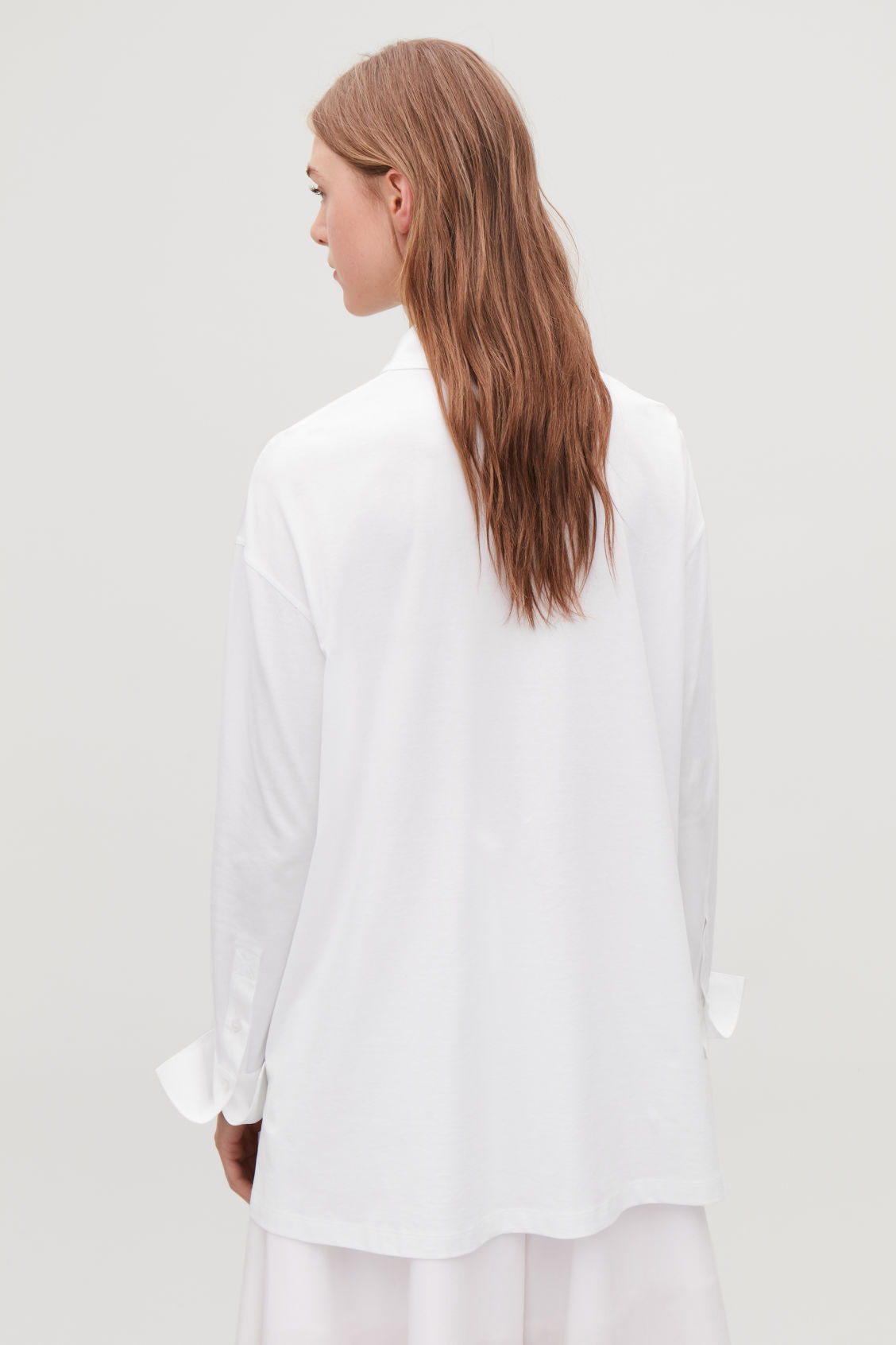 Model side image of Cos jersey-woven shirt with pleat in white