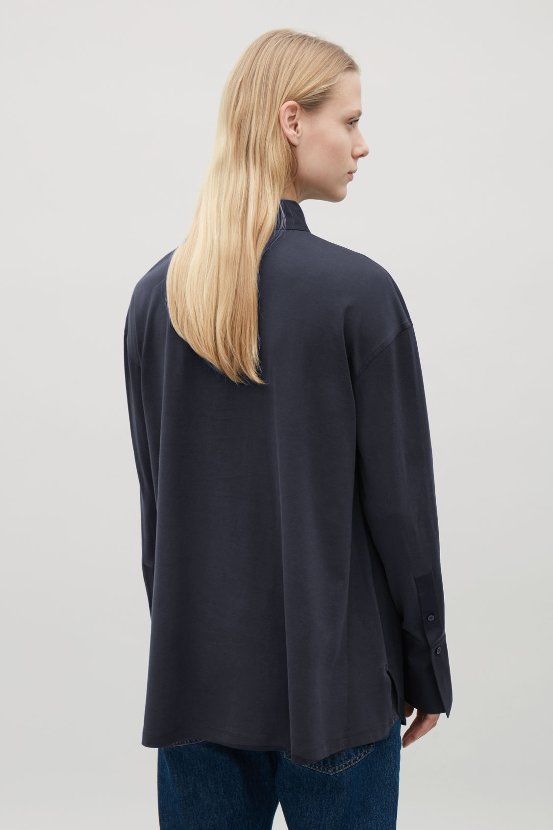 Model side image of Cos jersey-woven shirt with pleat in blue