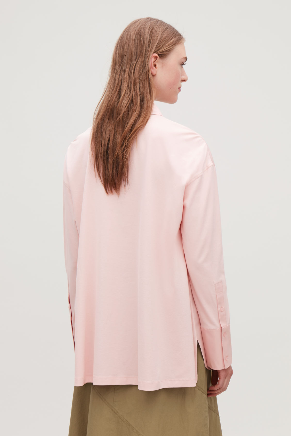 Model side image of Cos jersey-woven shirt with pleat in pink