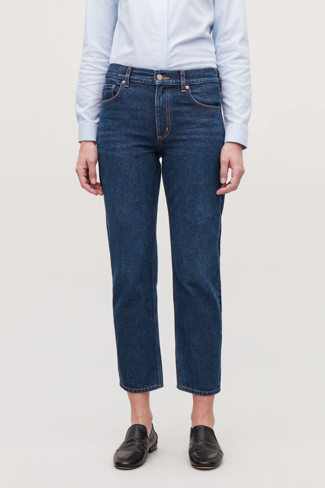 Model side image of Cos cropped slim-fit jeans in blue