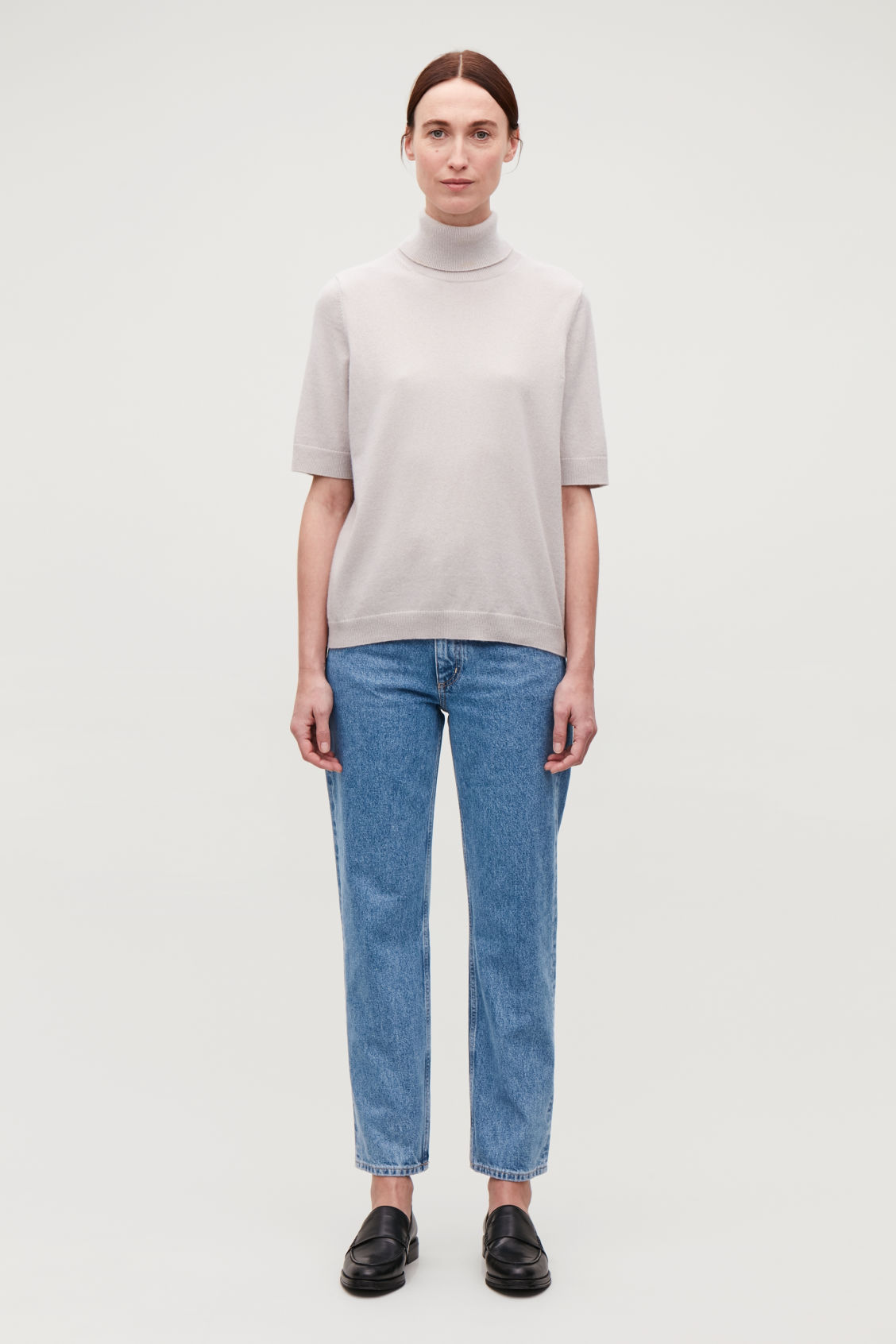Model front image of Cos cropped slim-fit jeans in blue