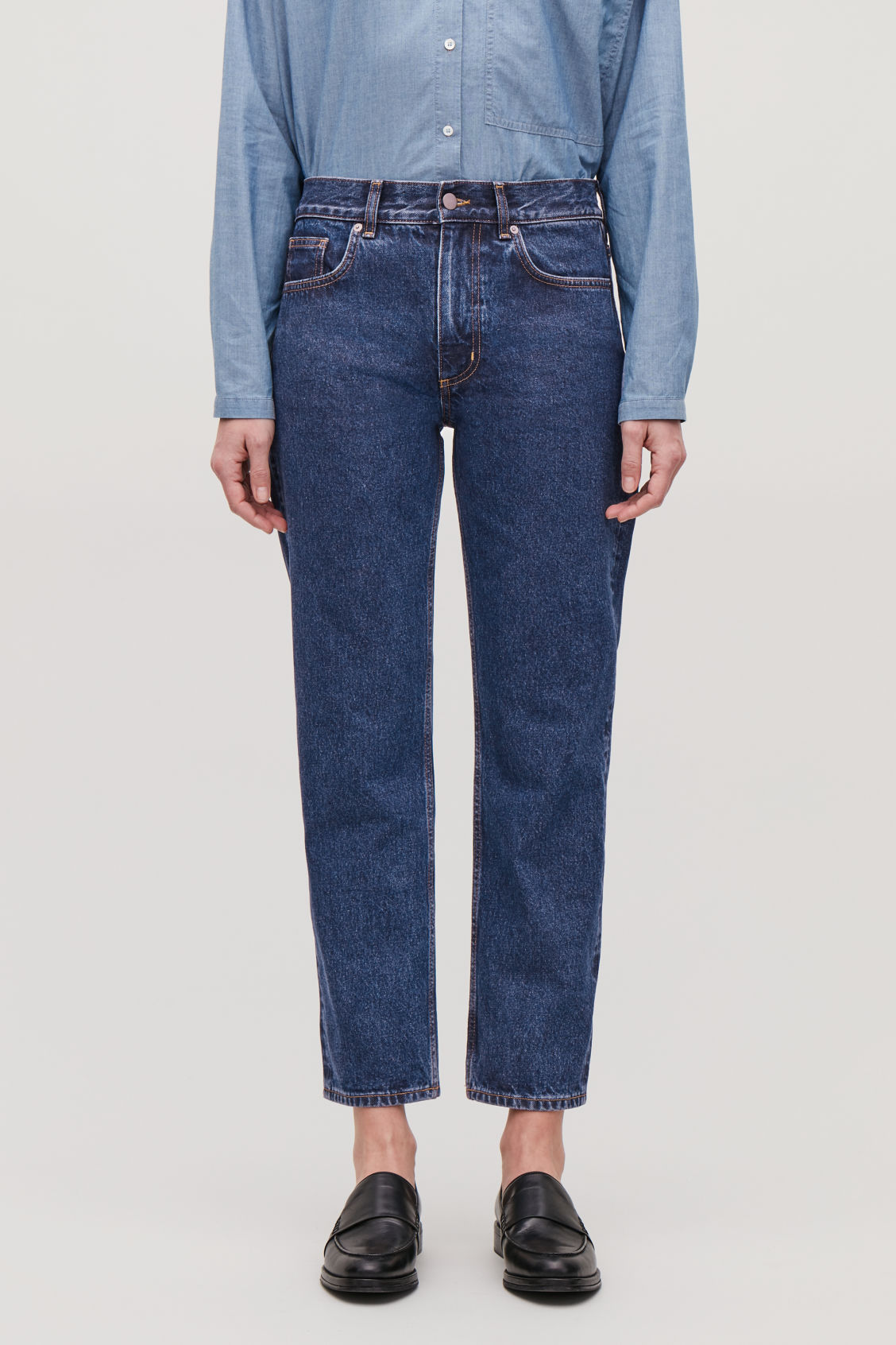 Model side image of Cos 28 inch slim crop jeans in blue