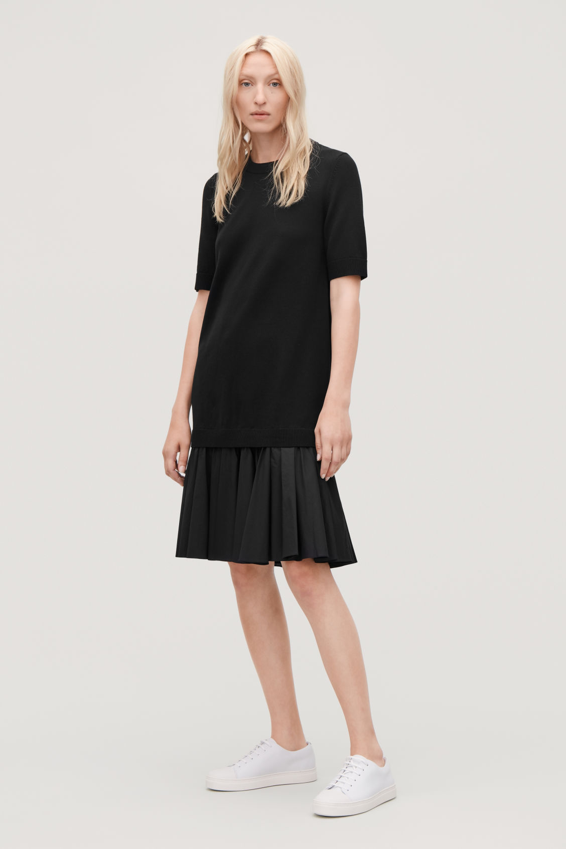 Model front image of Cos panelled cotton knit dress  in black