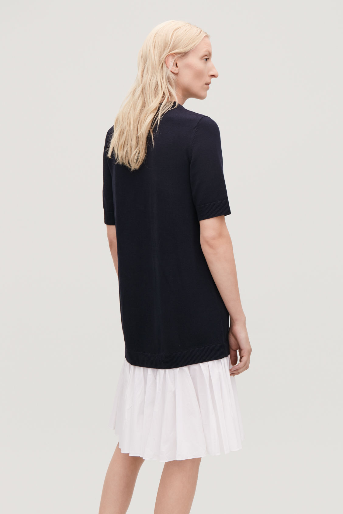 Model side image of Cos panelled cotton knit dress  in blue