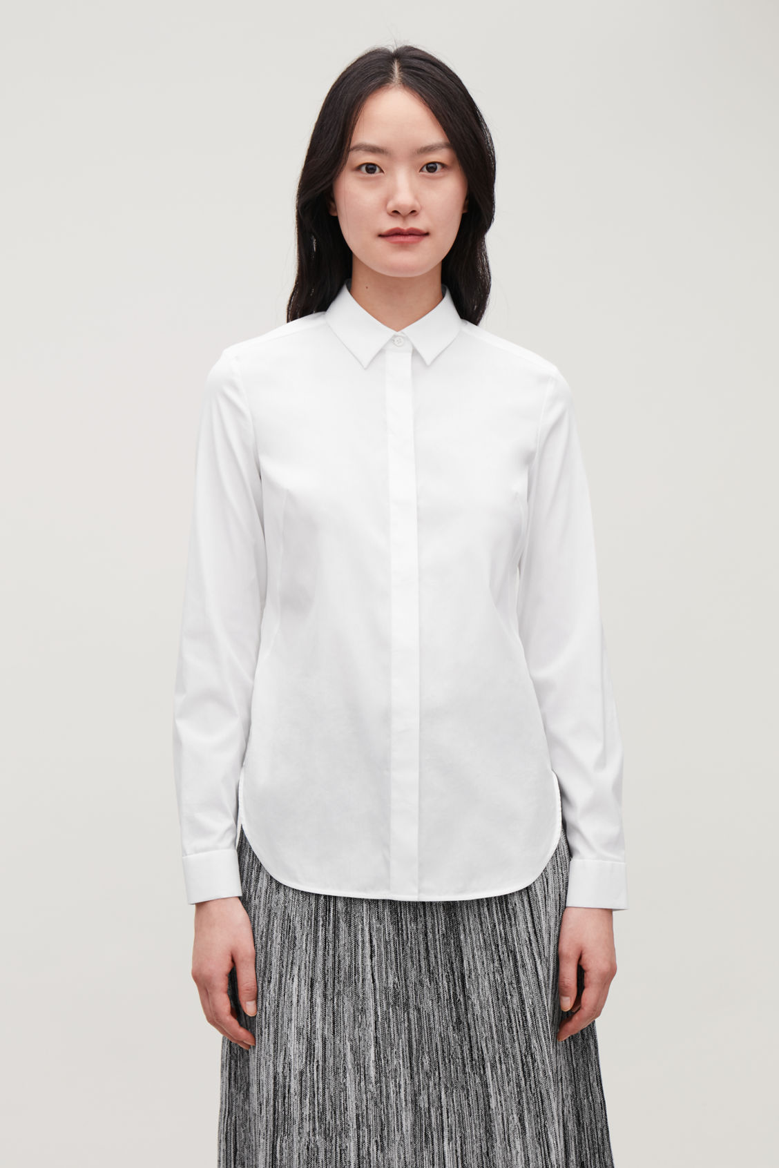 Model side image of Cos slim-fit shirt  in white