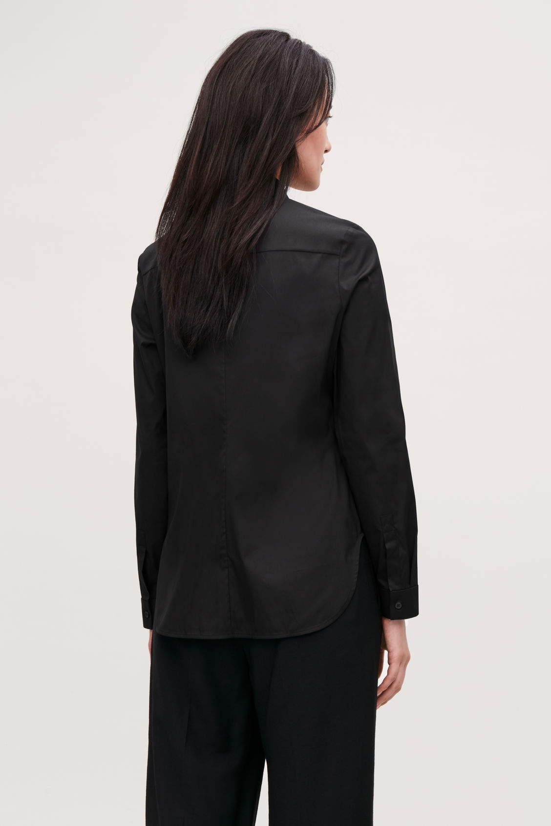 Model side image of Cos slim-fit shirt  in black