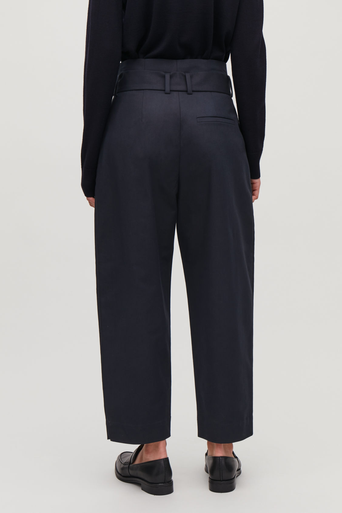 Model side image of Cos belted cotton trousers in blue