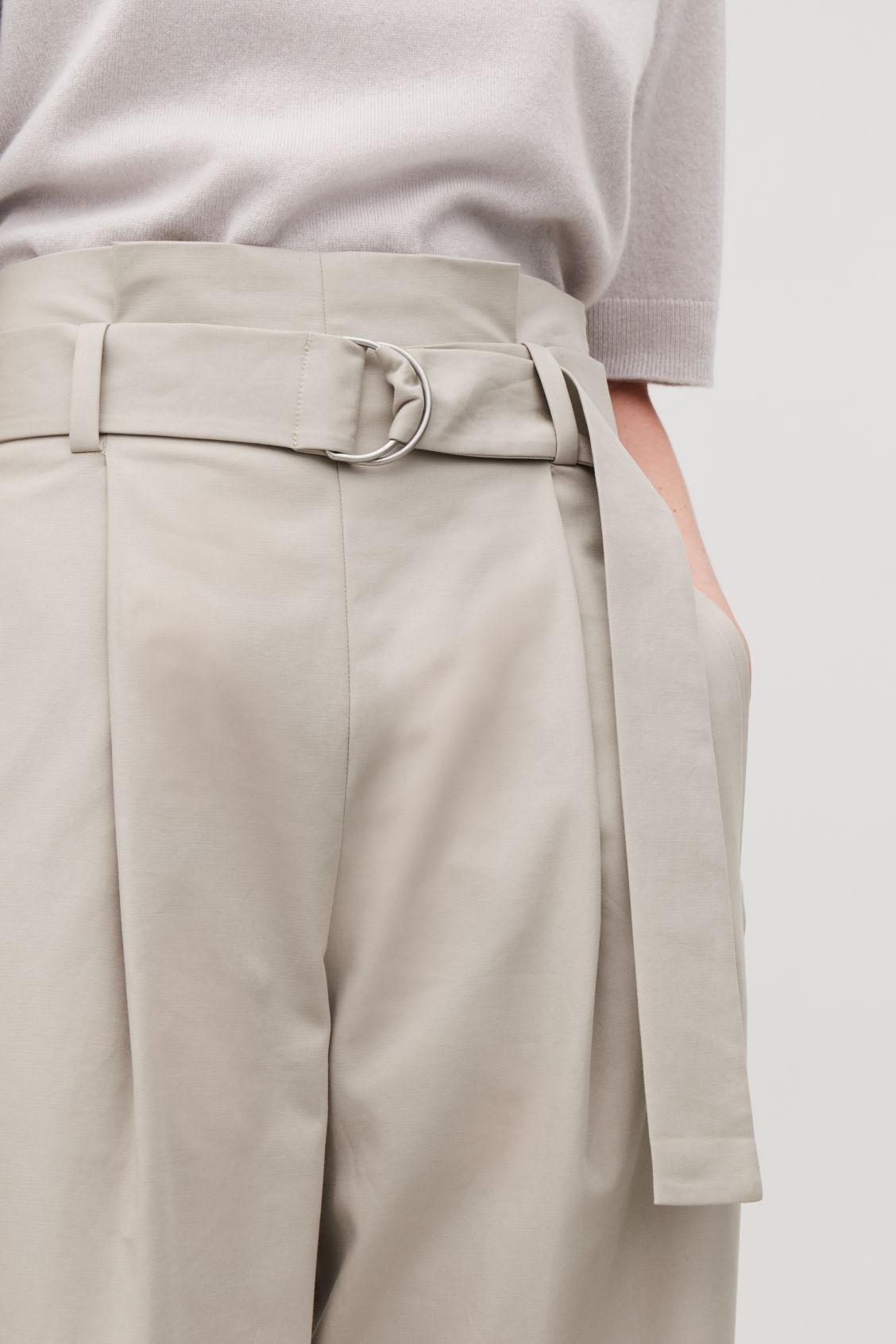 Model side image of Cos belted cotton trousers in brown