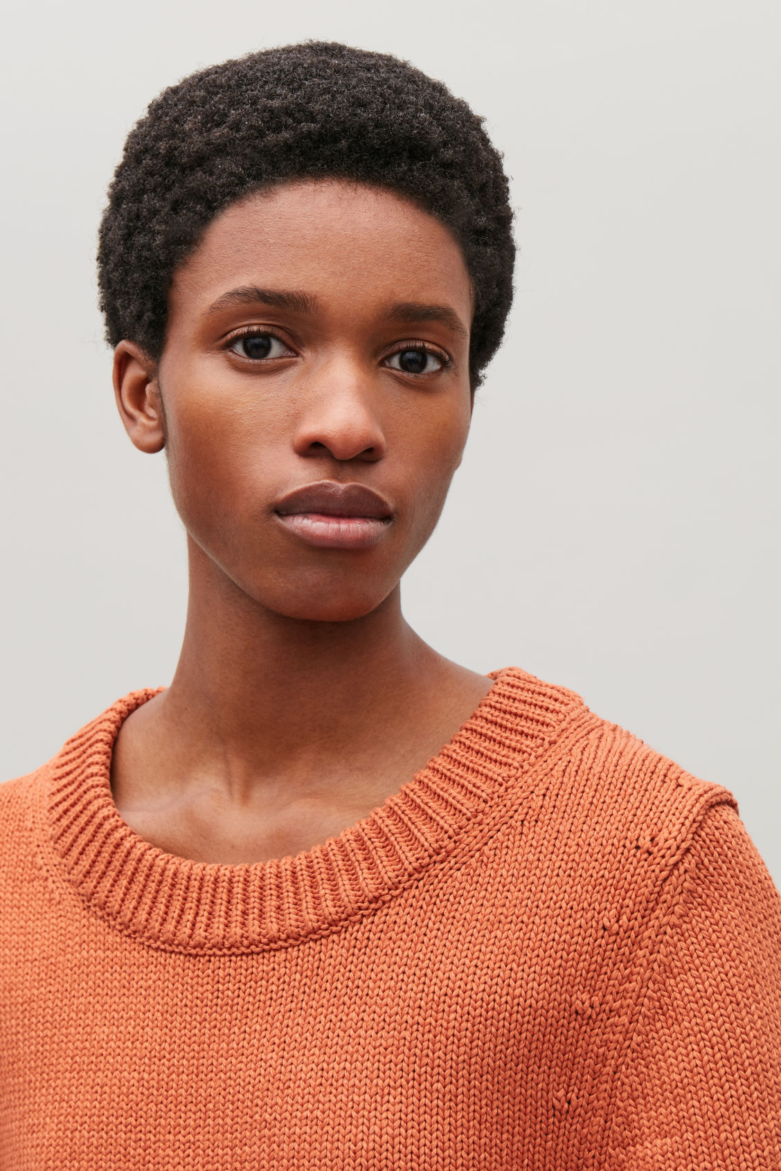 Model side image of Cos cotton-linen knit top in orange