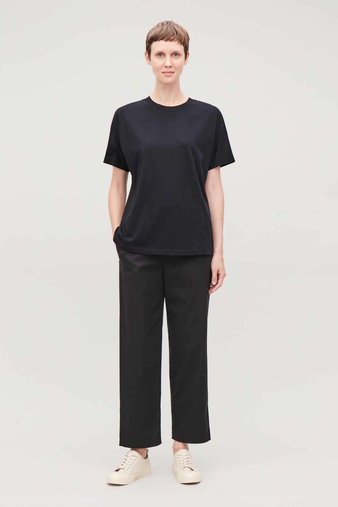 Model front image of Cos relaxed kimono-sleeved t-shirt in black
