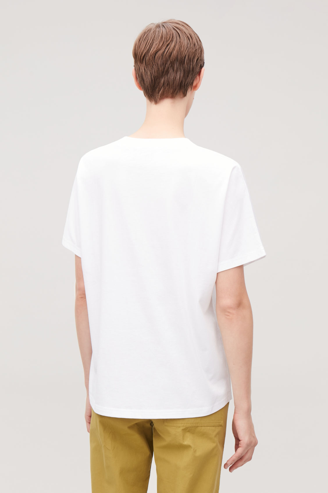 Model side image of Cos relaxed kimono-sleeved t-shirt in white