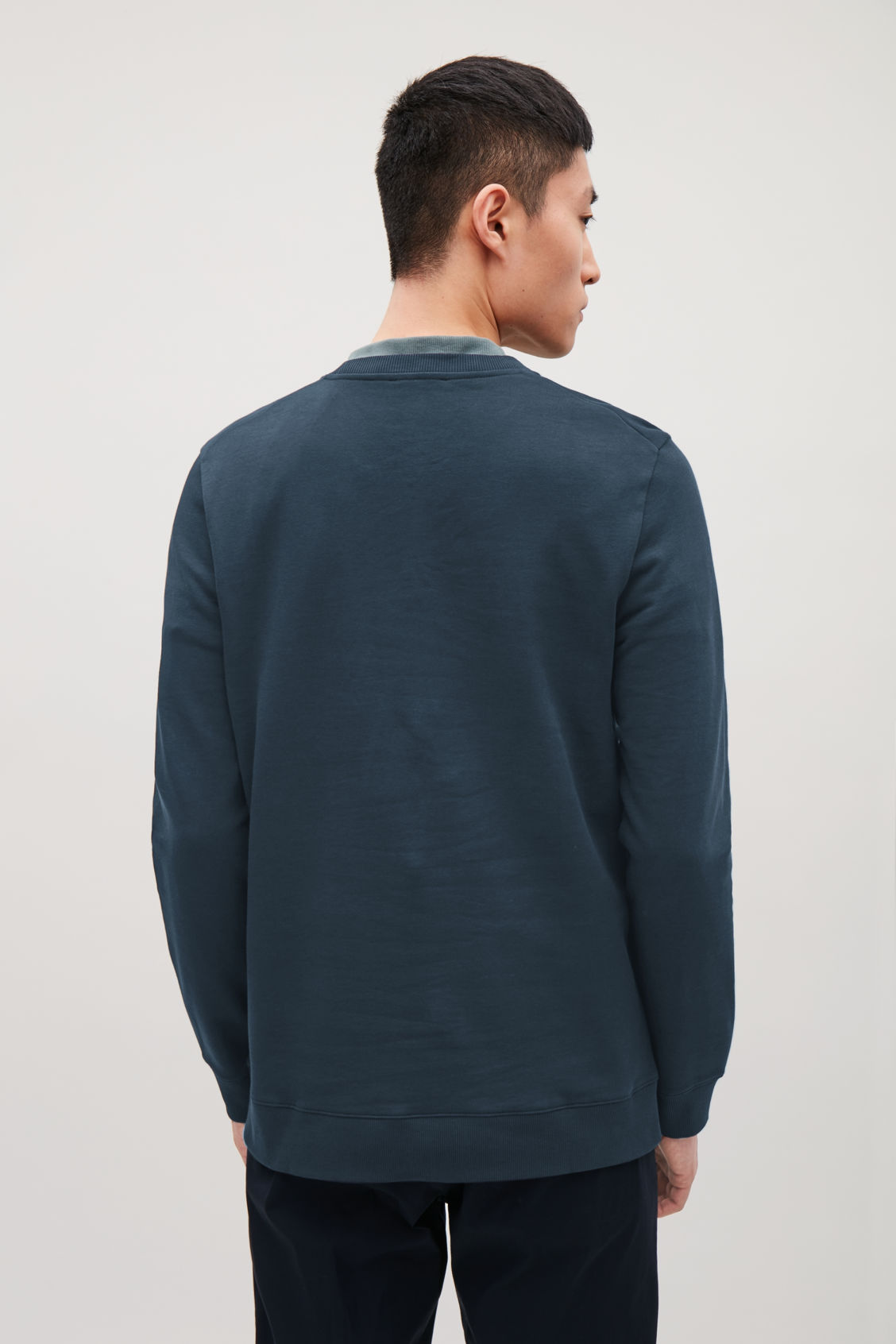 Model side image of Cos cotton crew-neck sweatshirt in blue