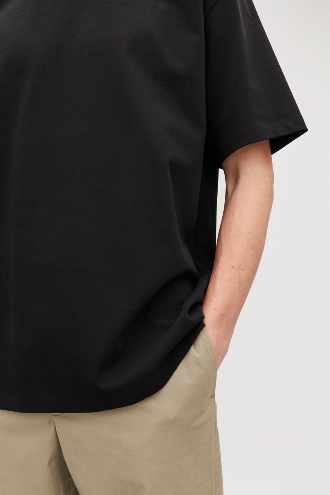 Model side image of Cos long cotton t-shirt  in black
