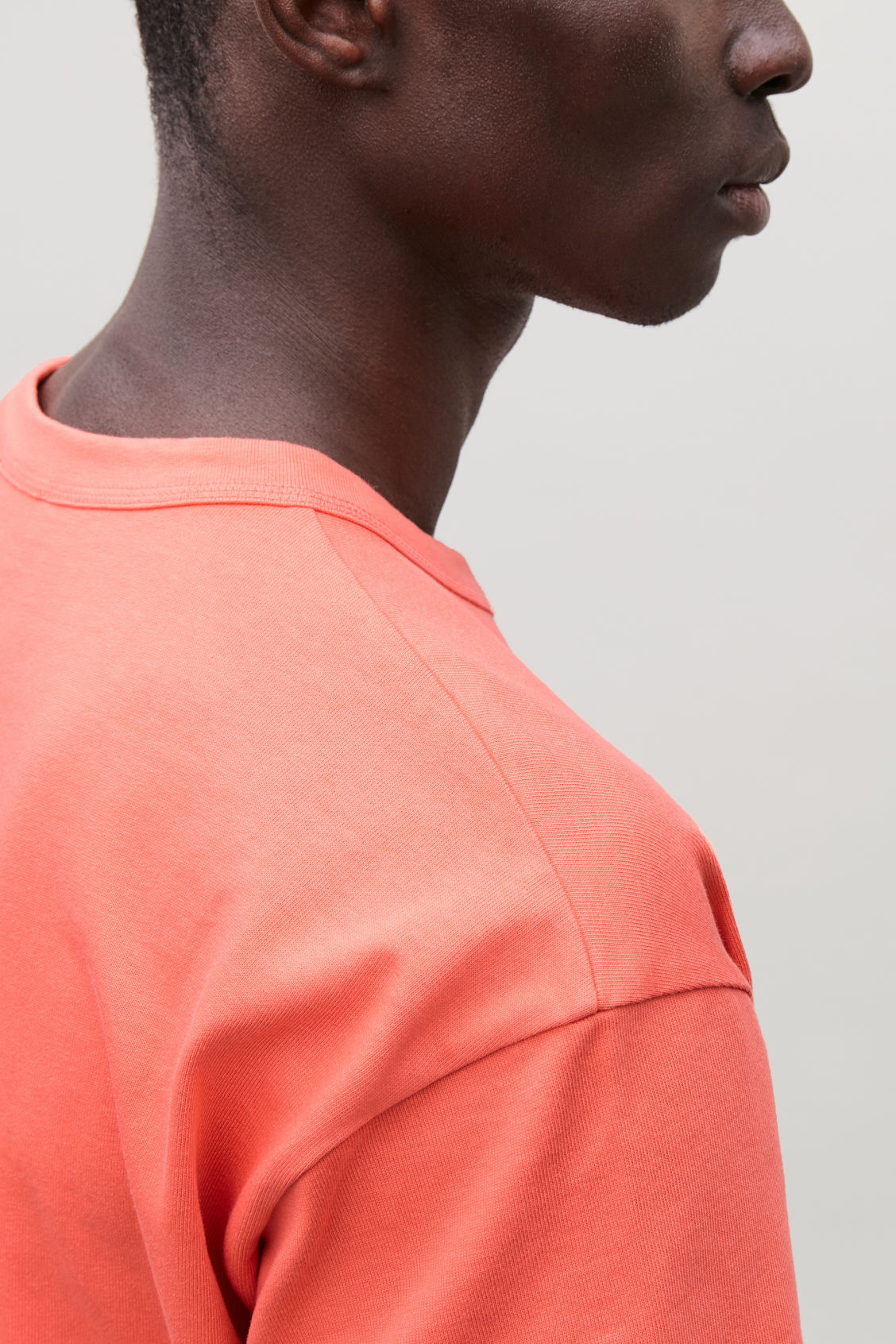 Model side image of Cos long cotton t-shirt  in orange