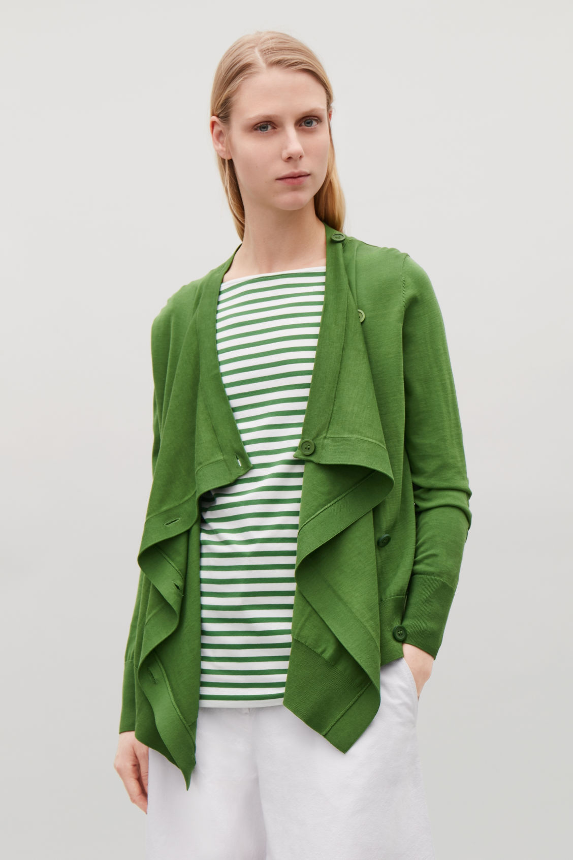 Model side image of Cos draped cotton cardigan  in green