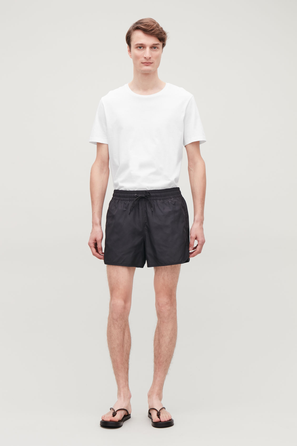 Model front image of Cos swim shorts in black