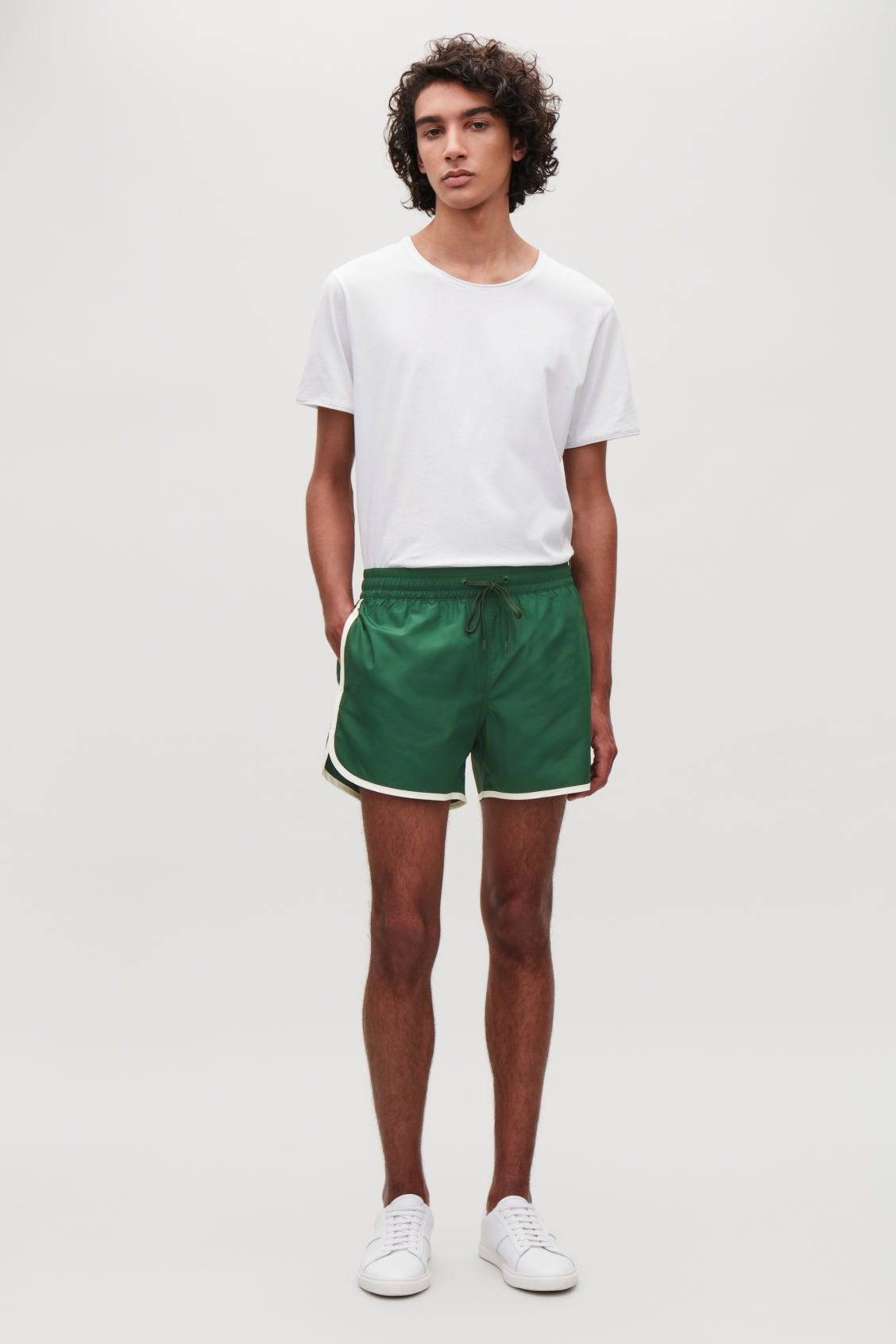 Model front image of Cos swim shorts in green