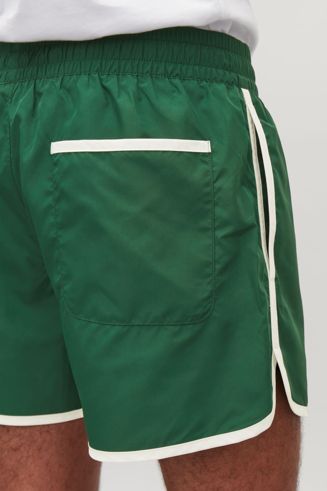 Model side image of Cos swim shorts in green