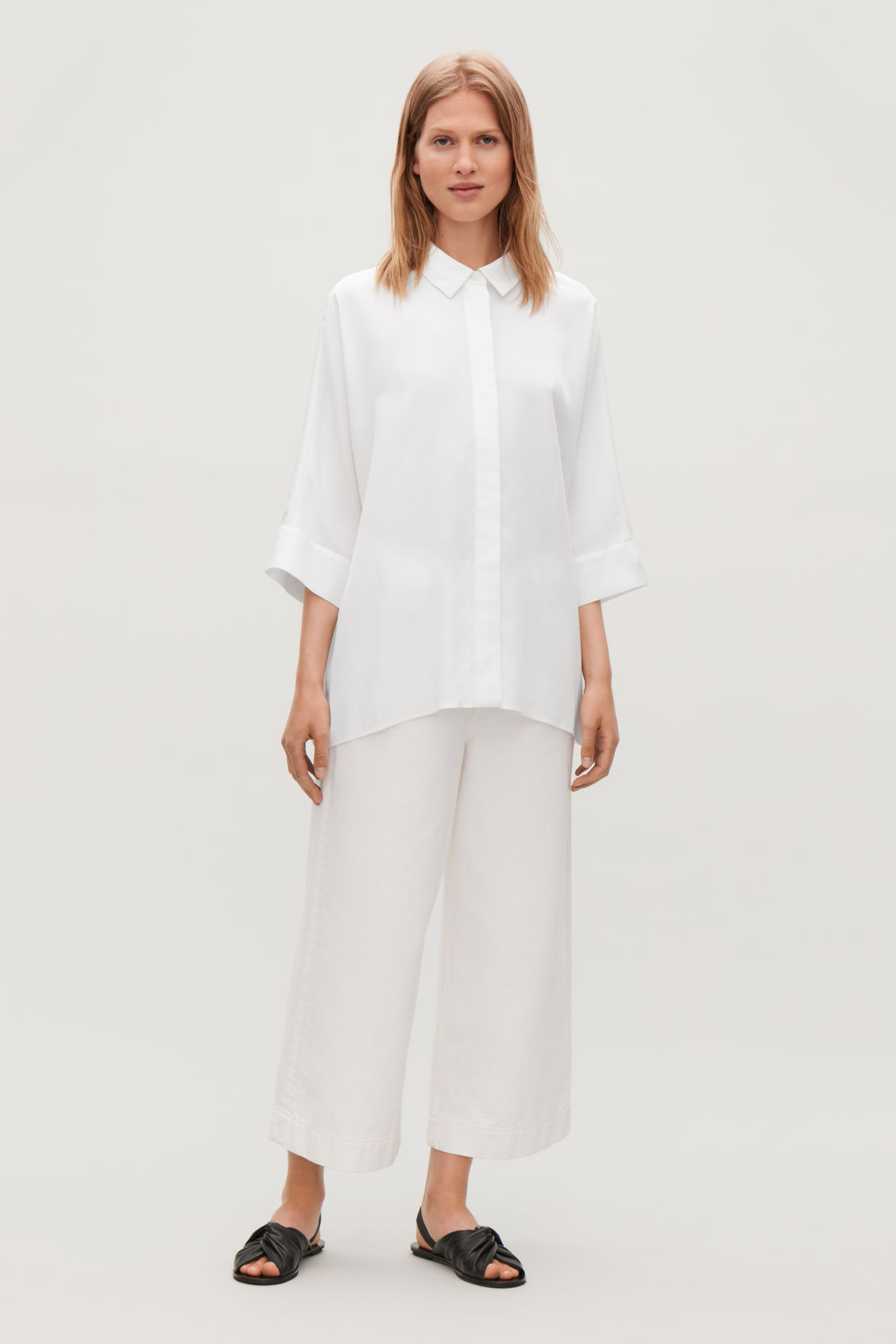 Model front image of Cos draped wide-fit shirt  in white