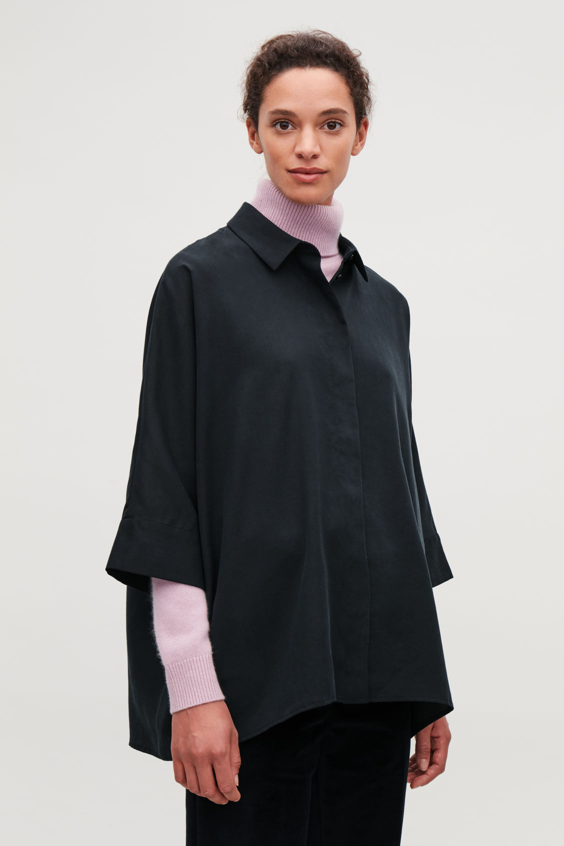 Model side image of Cos draped wide-fit shirt  in blue