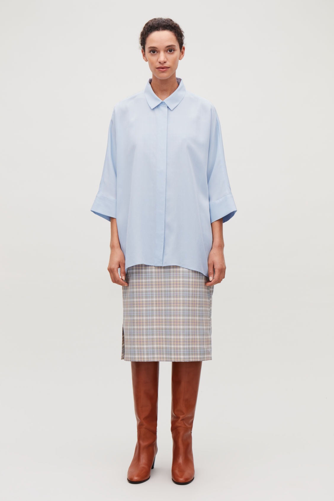 Model front image of Cos draped wide-fit shirt  in blue
