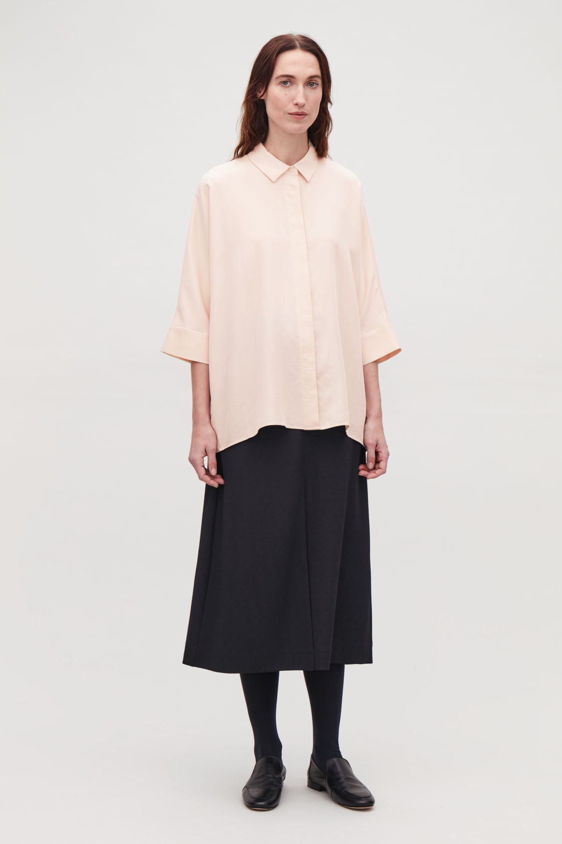 Model front image of Cos draped wide-fit shirt  in beige