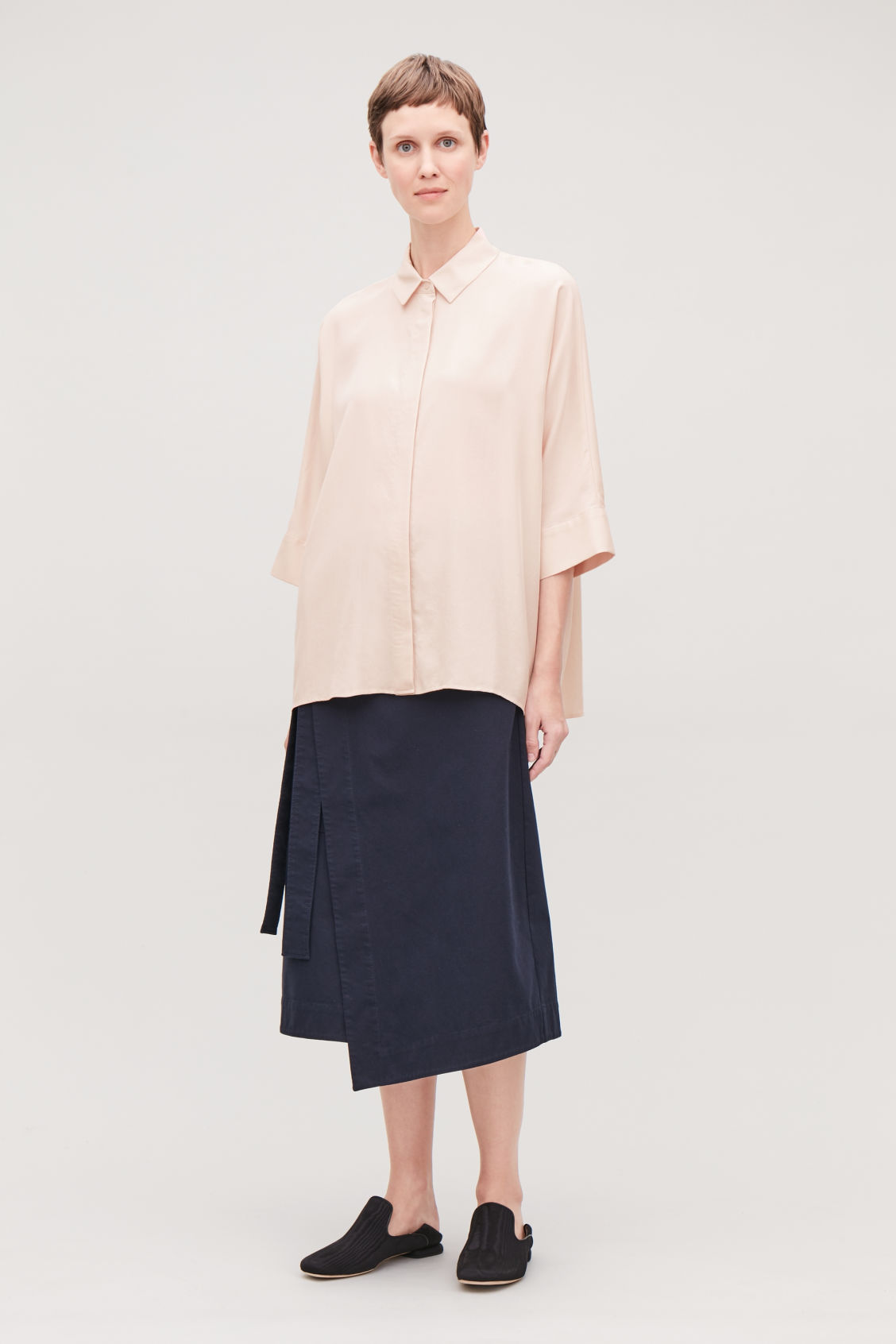 Model side image of Cos draped wide-fit shirt  in beige