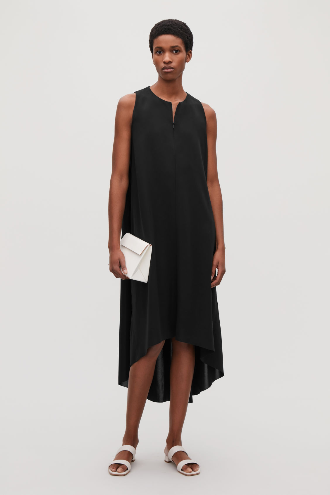 Model front image of Cos sleeveless dress with pleats in black