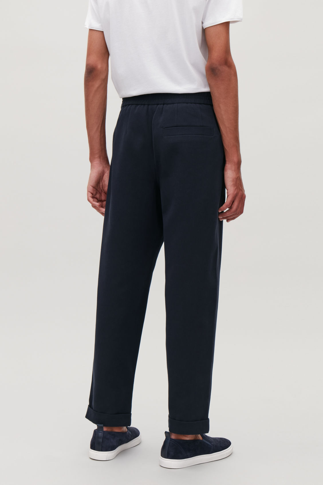 Model side image of Cos tapered cotton trousers in blue