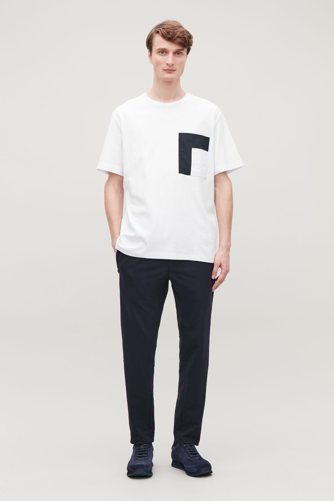 Model front image of Cos t-shirt with contrast pocket in white