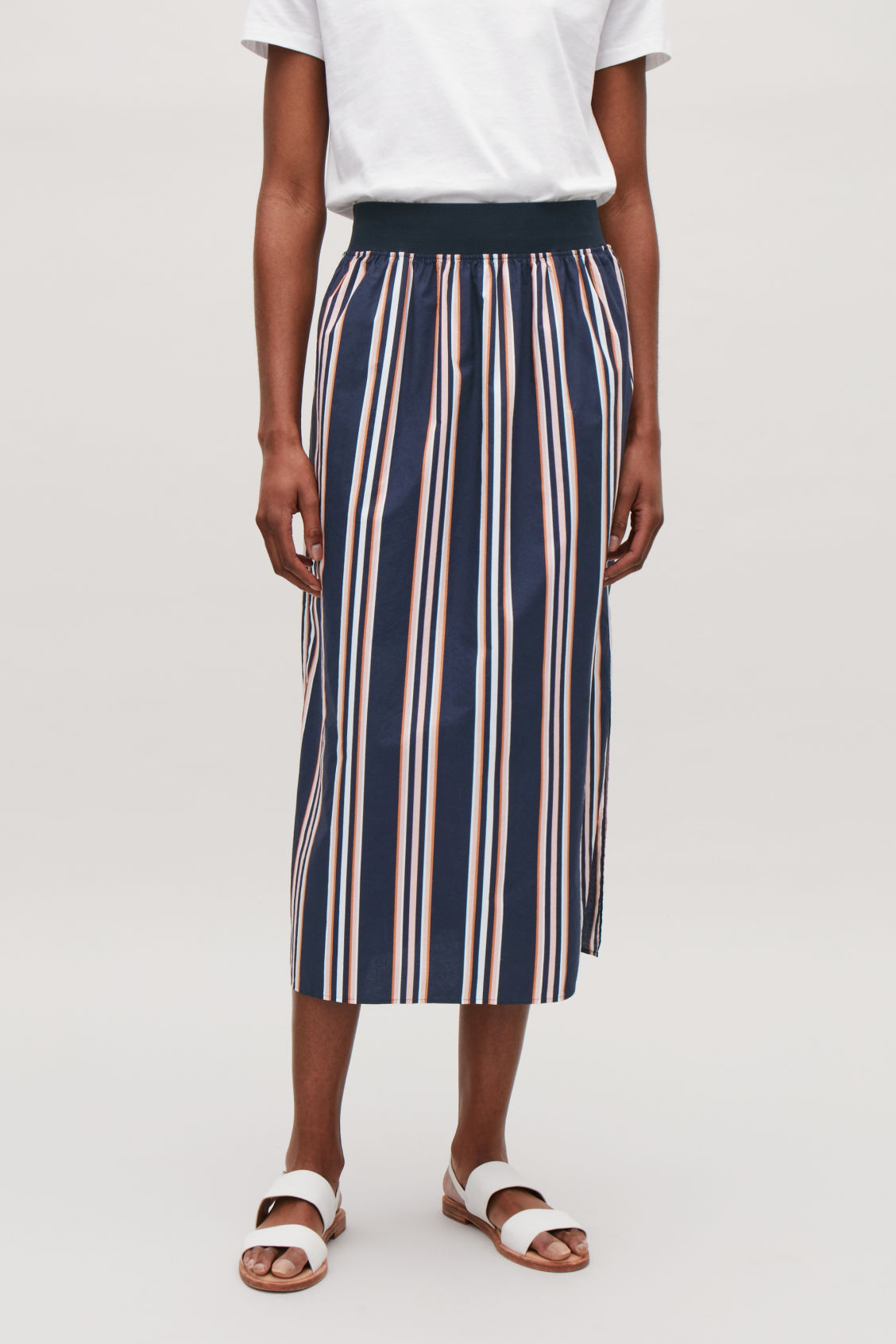 Model side image of Cos wide-elastic cotton skirt in blue