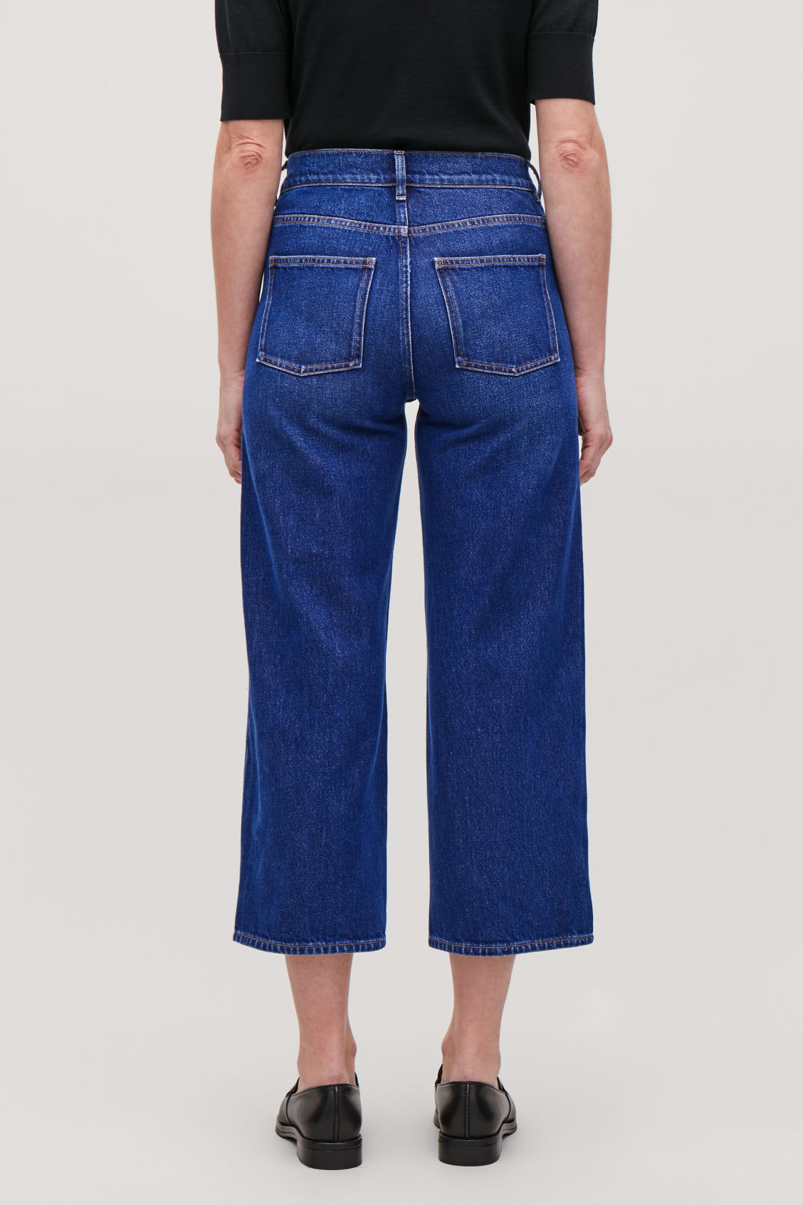 Model side image of Cos straight cropped jeans in blue