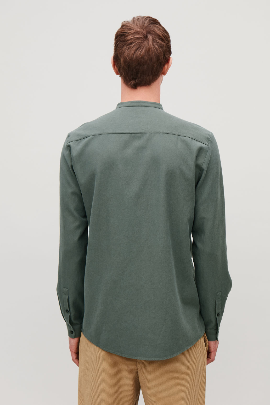 Model side image of Cos grandad-collar shirt with pocket in green