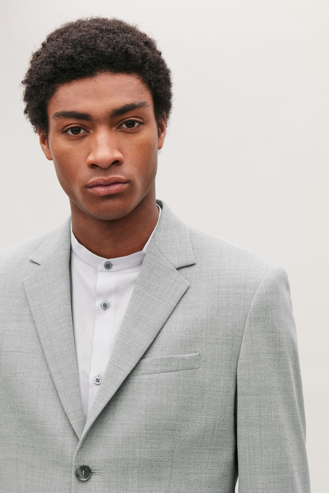 Model side image of Cos higher-break wool blazer  in grey