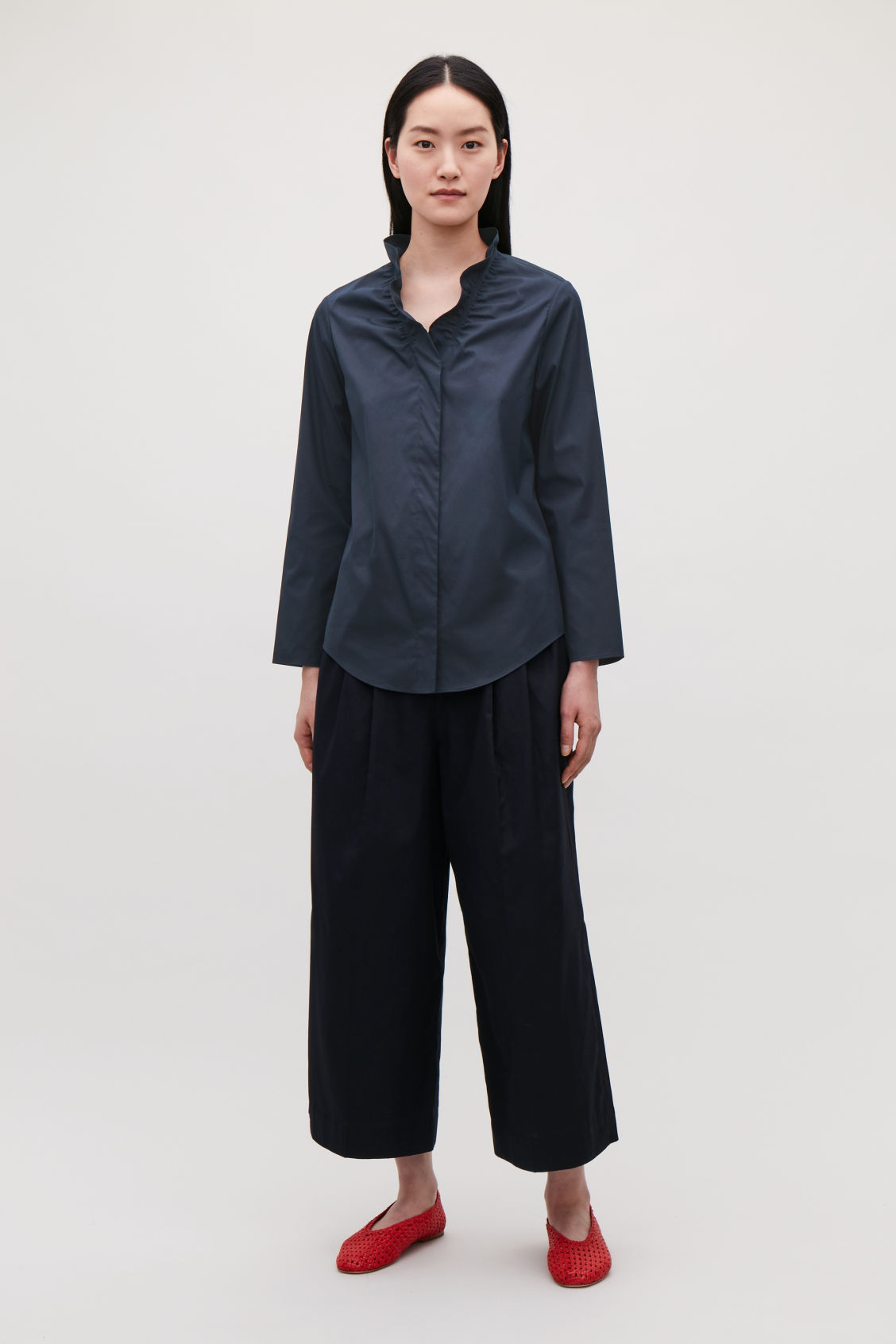 Model front image of Cos buttoned blouse with frill v-neck in blue