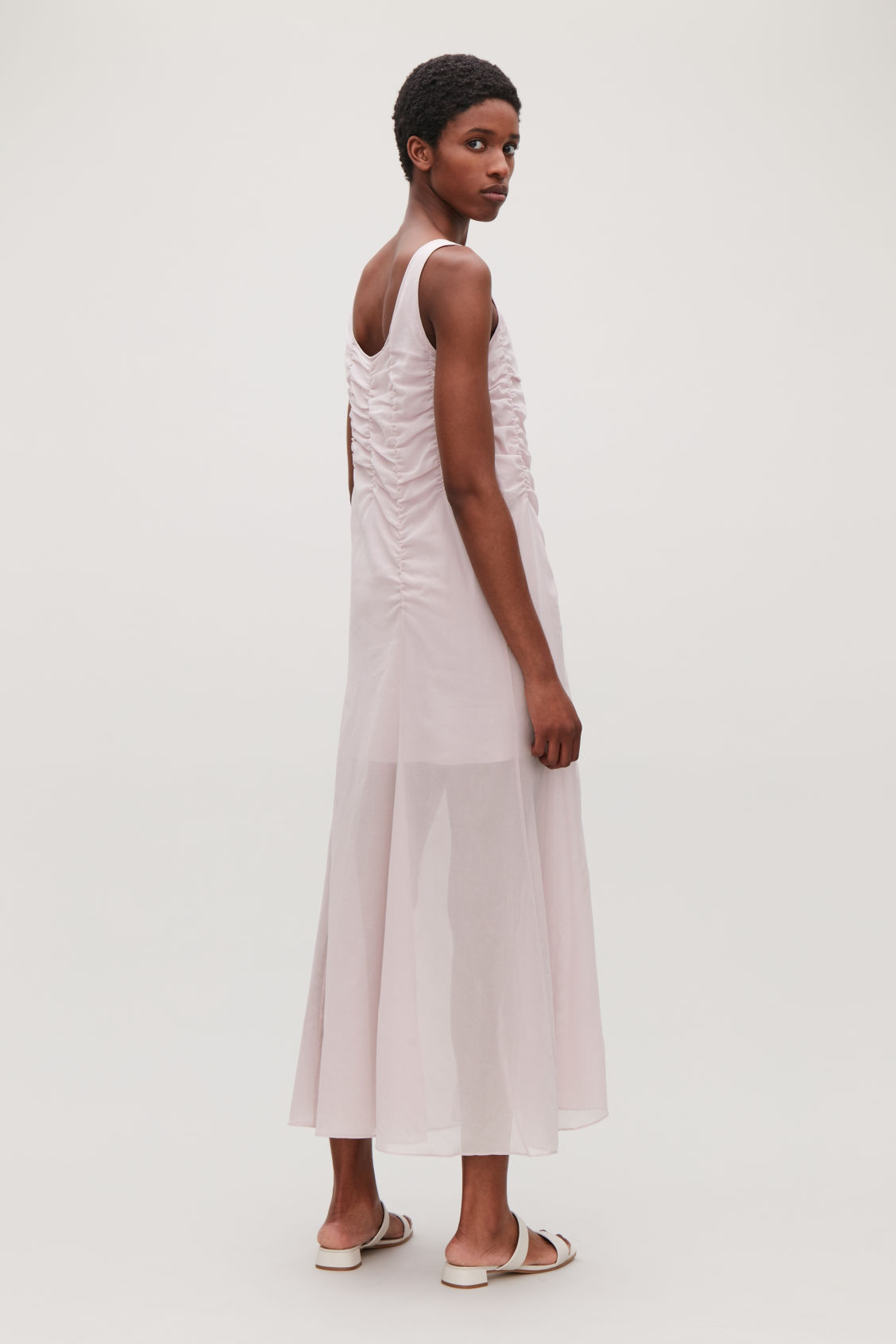 Model side image of Cos sleeveless gathered dress in pink