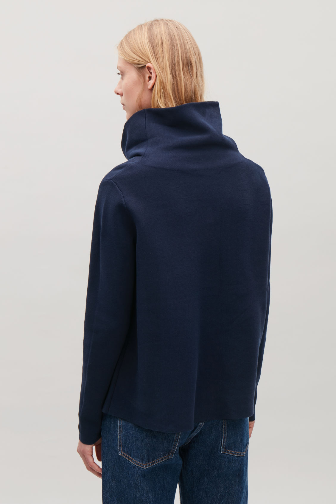 Model side image of Cos high-neck a-line jumper in blue