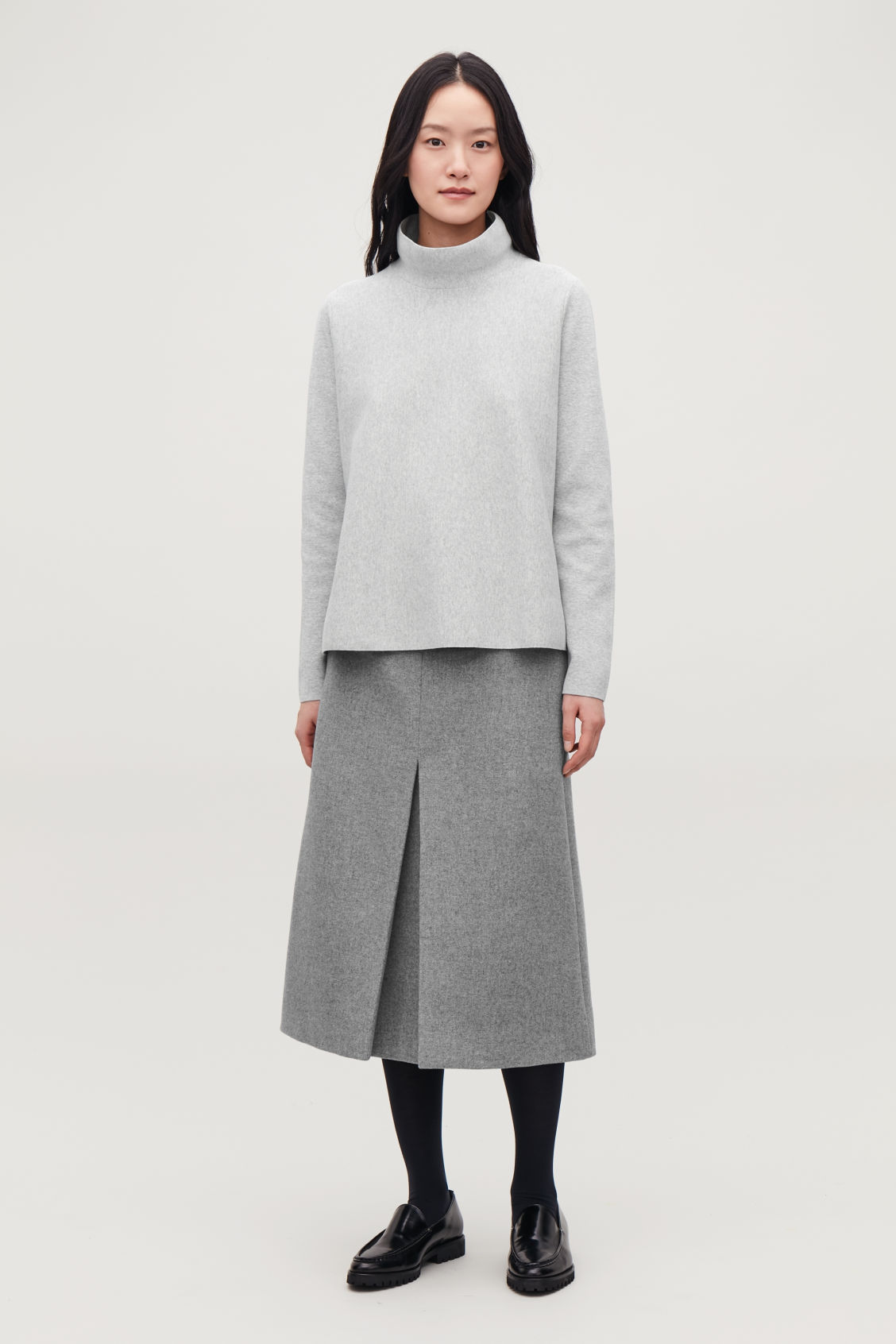 Model front image of Cos high-neck a-line jumper in grey