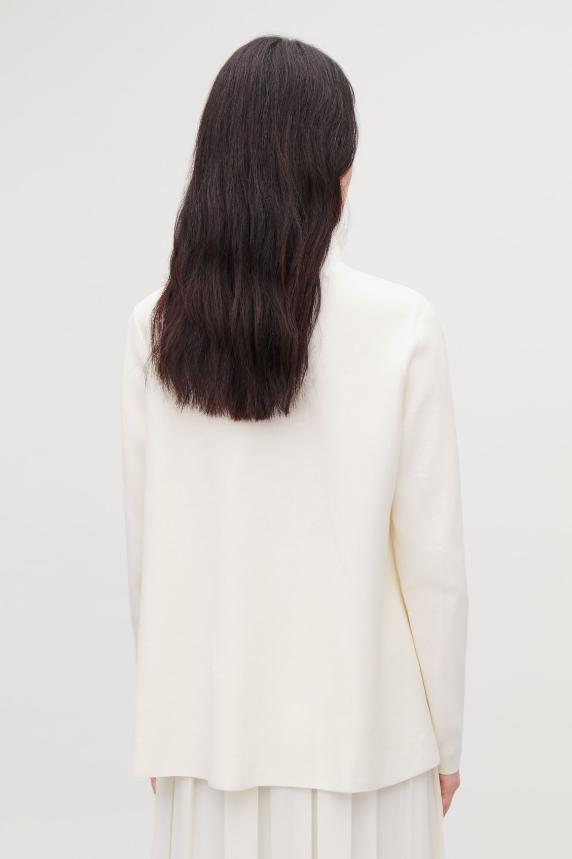 Model side image of Cos high-neck a-line jumper in white