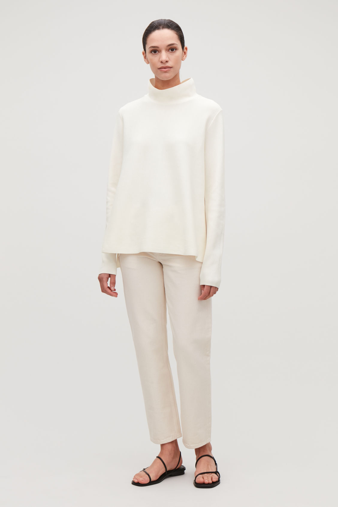 Model side image of Cos high-neck a-line jumper in cream