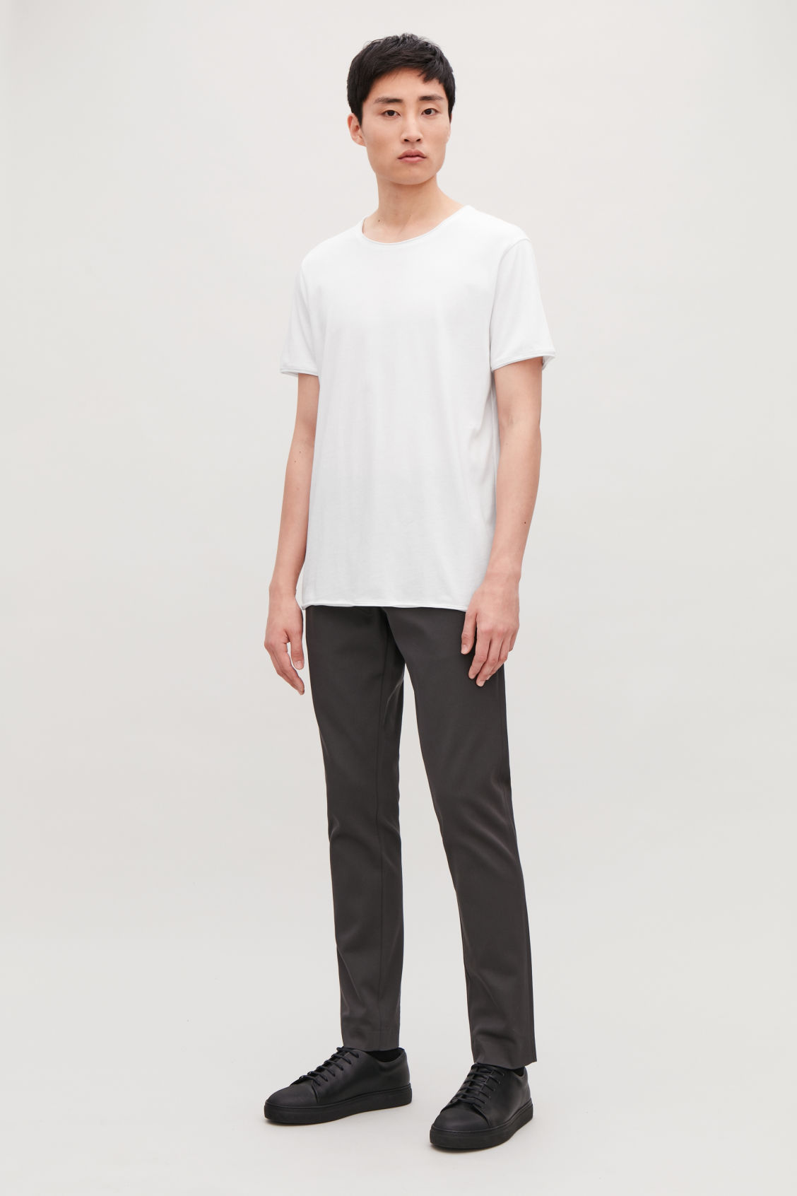 Model front image of Cos t-shirt with rolled edges in white
