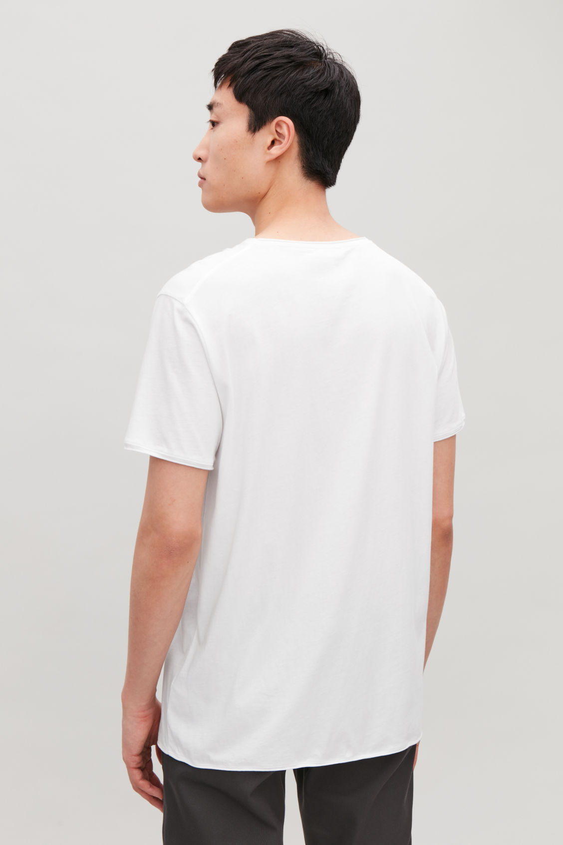 Model side image of Cos t-shirt with rolled edges in white