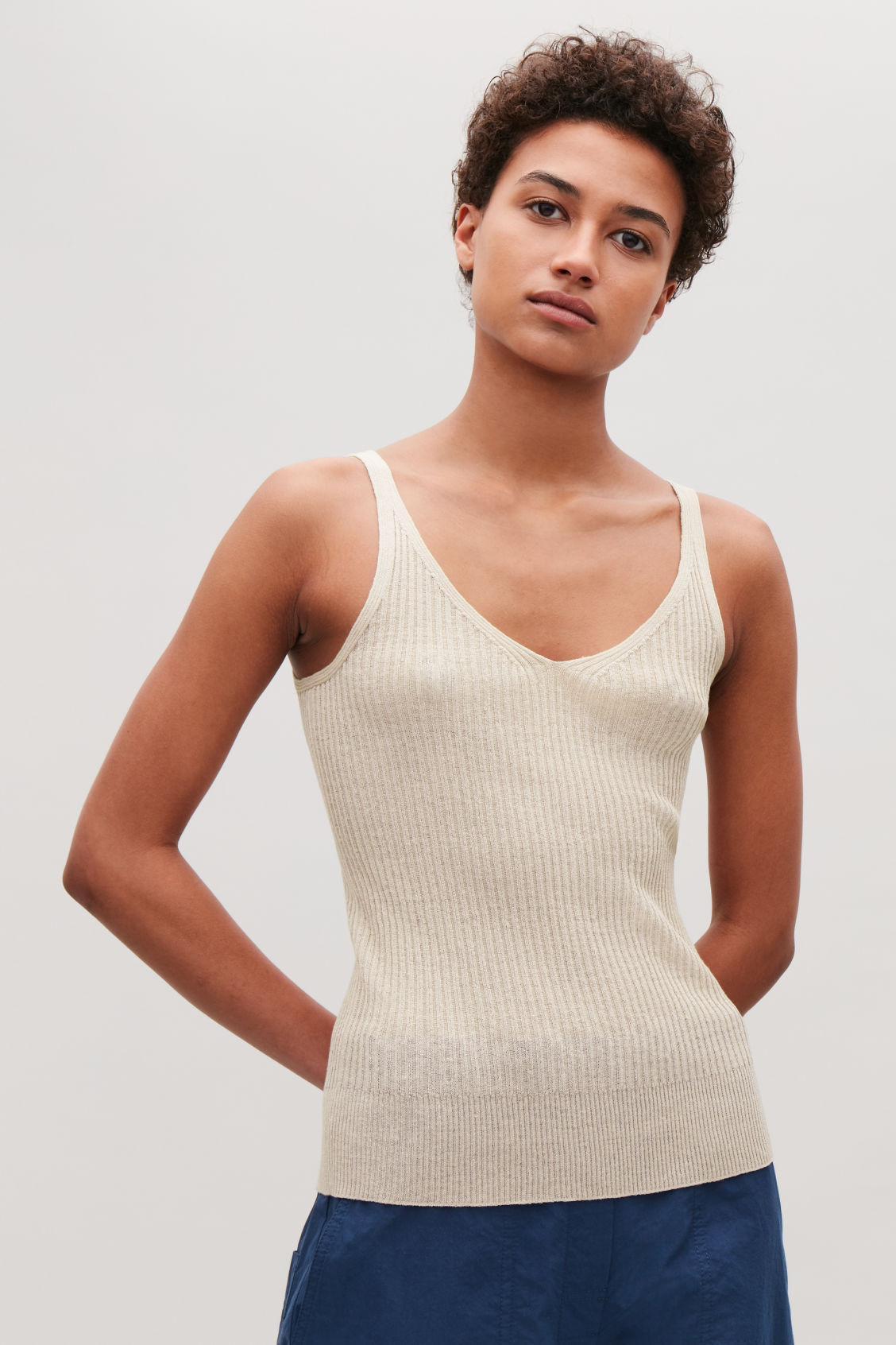 Model side image of Cos knitted vest top in pink