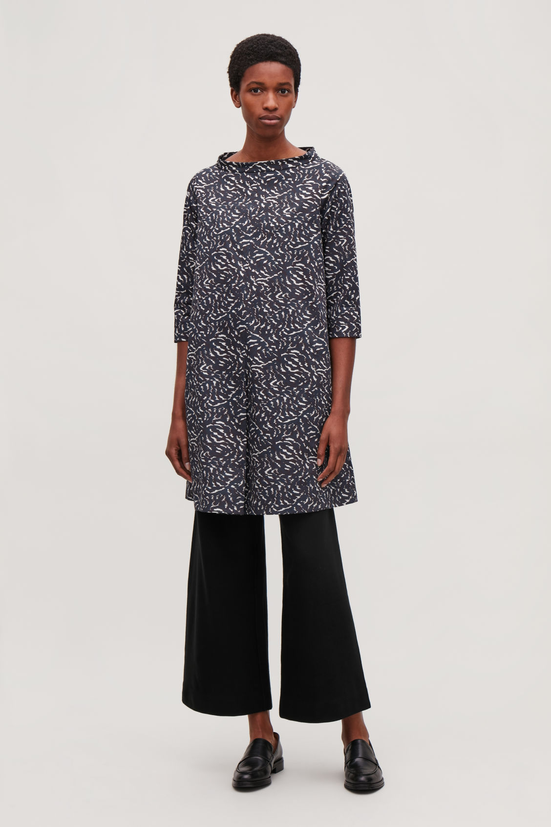 Model side image of Cos raised-collar printed dress in blue