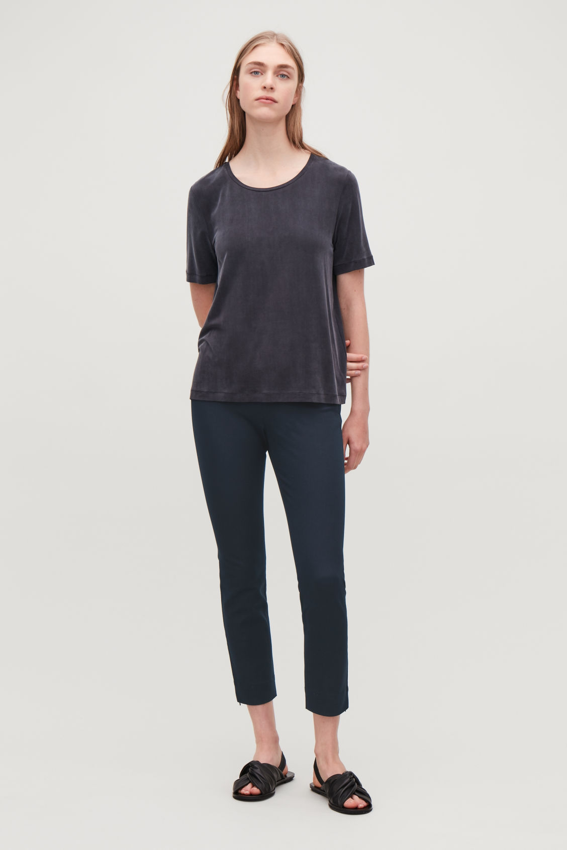 Model front image of Cos slim-fit trousers with ankle zips  in blue